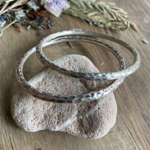 Set of (2) Sterling silver hammered bangles